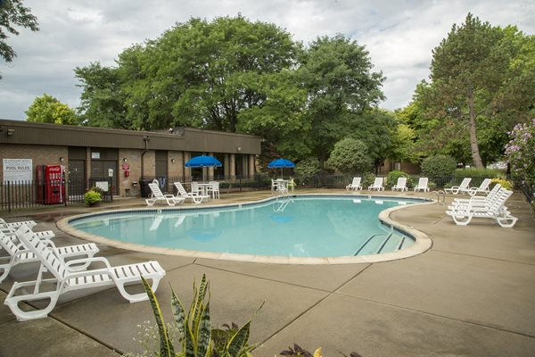 Heated Pool (open April - October) with large sundeck at Westwood Village Apartments in Westland, MI