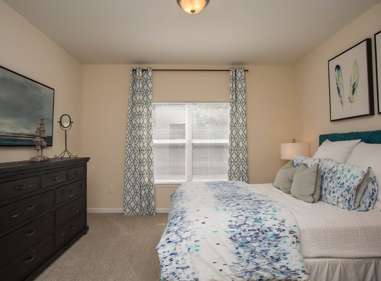 Daylight radiates through the blinds in a bedroom at The Apartments at the Venue near LaGrange, GA.