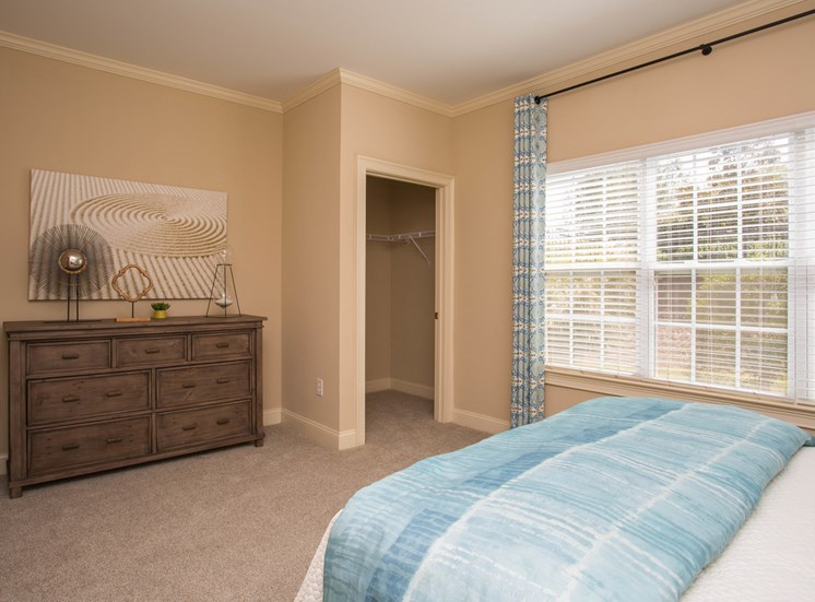 New carpet, fresh paint, large windows, and closet space in a bedroom at The Apartments at the Venue near LaGrange, GA.