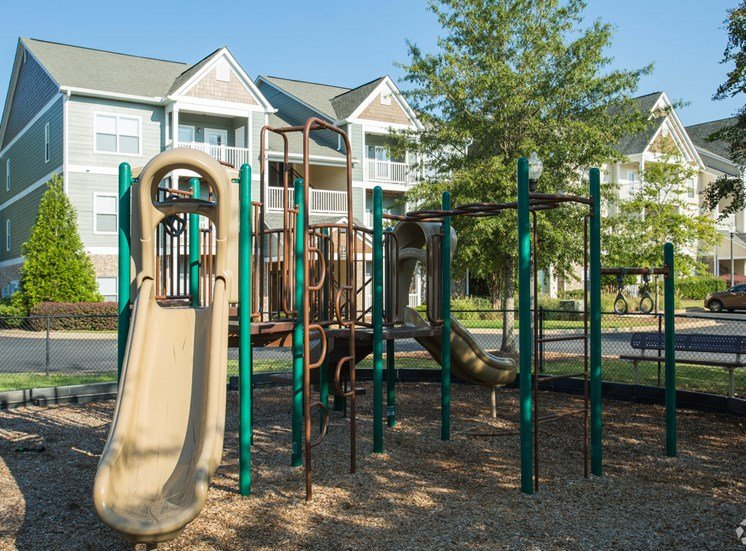 An outdoor playground sits ready for kids on the grounds of The Apartments at the Venue near LaGrange, GA.