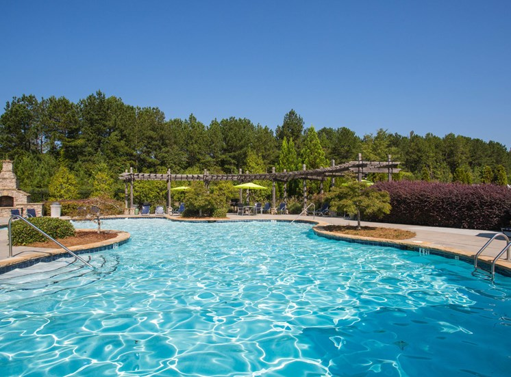 The large, long clear swimming pool sits ready for swimmers at The Apartments at the Venue near LaGrange, GA.