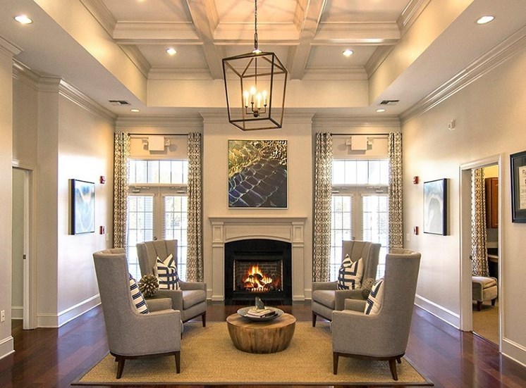 The Verandas clubhouse sports a classy fireplace area with four tall chairs at The Apartments at the Venue near LaGrange, GA.