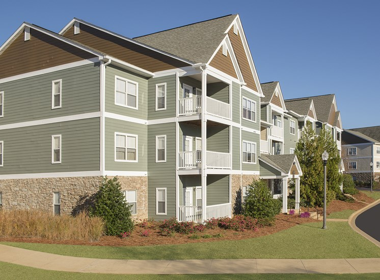 The green, three-story Verandas apartments rest quietly at The Apartments at the Venue near LaGrange, GA.