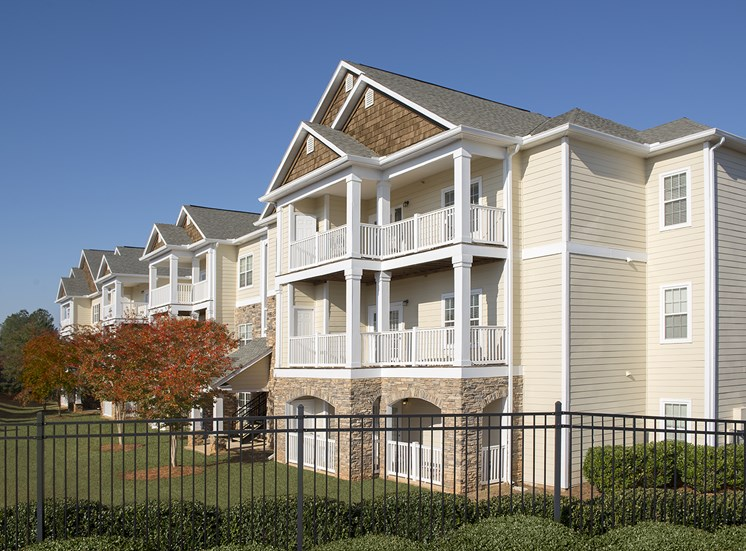 The Vistas apartments sit inside the gate with ample lawn area at The Apartments at the Venue near LaGrange, GA.