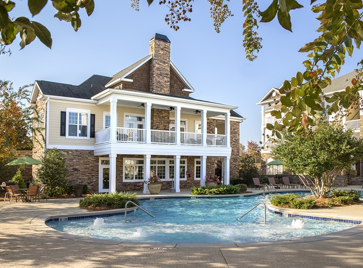 The Vistas resort-style pool with bubbling jets sits ready at The Apartments at the Venue near LaGrange, GA.