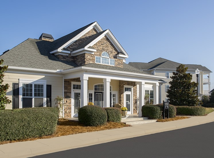 Square columns surround the entrance of the Vistas clubhouse at The Apartments at the Venue near LaGrange, GA.