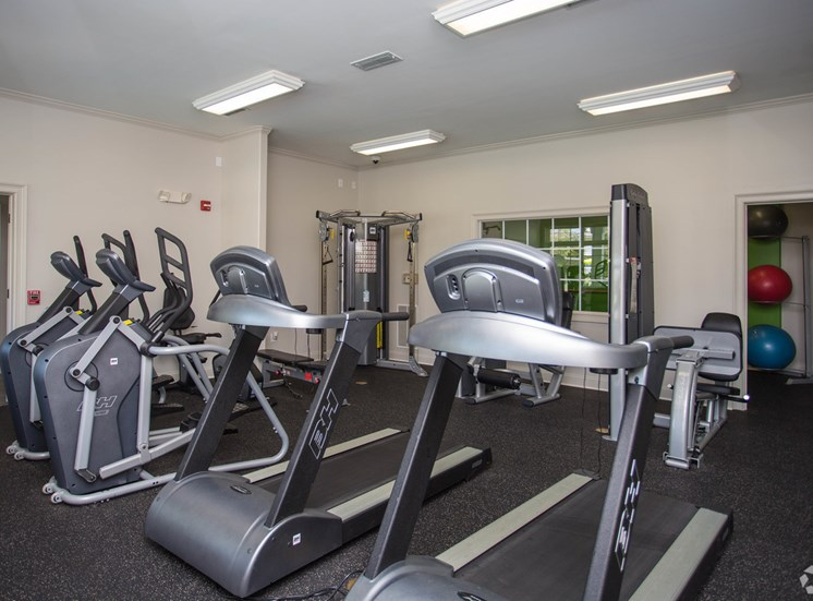 Treadmills, elliptical machines, yoga balls and more in the fitness center at The Apartments at the Venue near LaGrange, GA.