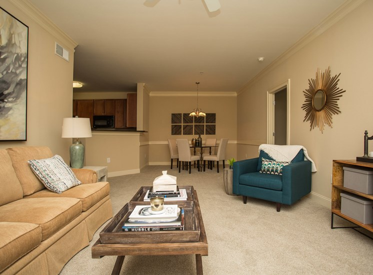 View from the end of a living room reveals the open floor plan of a unity at The Apartments at the Venue near LaGrange, GA.