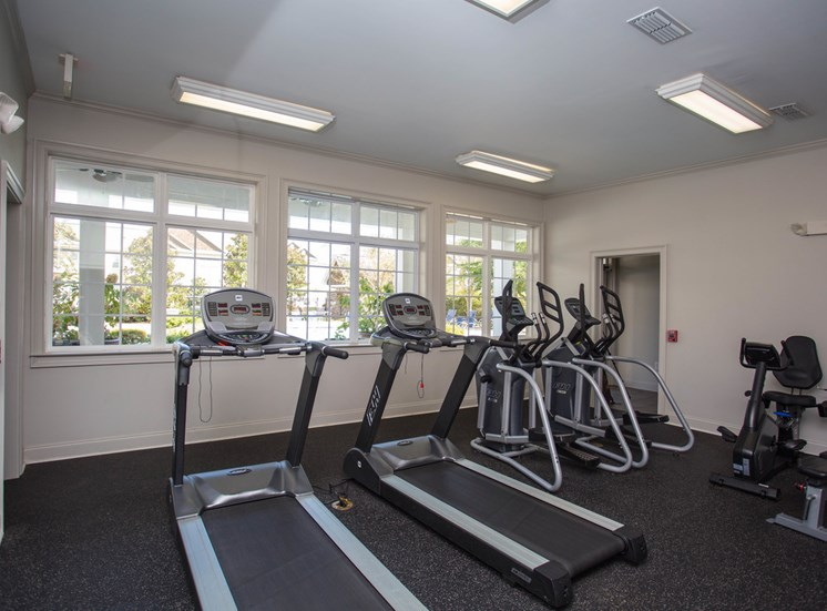 Treadmills and ellipitical machines sport an excellent view of the outside at The Apartments at the Venue near LaGrange, GA.