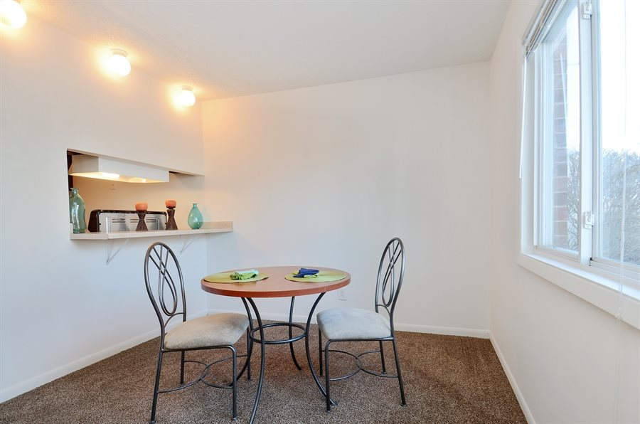 Apartments at Pangea Vineyards in Indianapolis include amenities like a dining area!