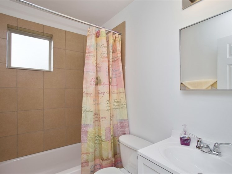 Updated bathroom in apartments for rent at Pangea Oaks in Baltimore.