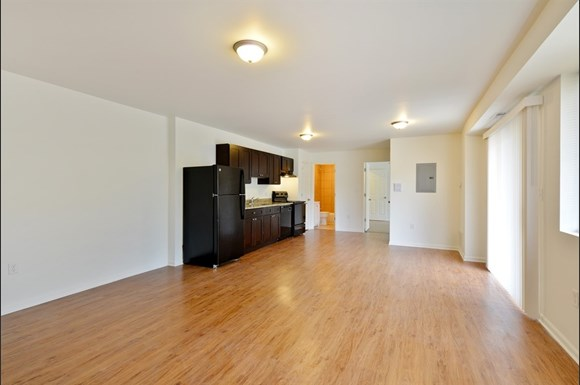 Pangea Pines Apartments feature hardwood floors and appliances in updated units.