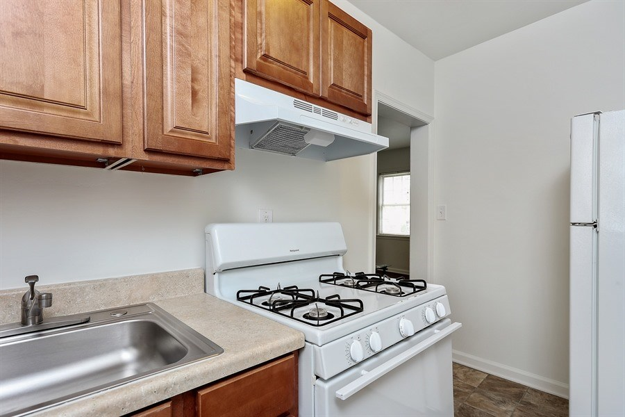 Apartments in Baltimore feature kitchens with appliances and updated cabinetry.