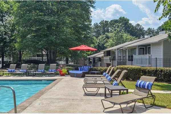 Swimming Pool with Lounge Chairs and Sundeck at Woodland Hills, Decatur, Georgia