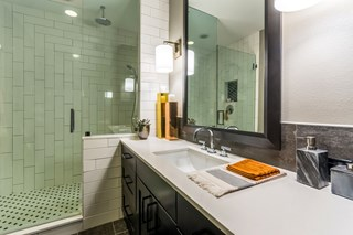 Large apartment bathroom with mirror