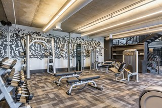 spacious gym with multiple exercise equipment pieces