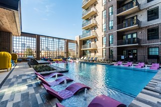 apartment complex resort-style pool outside during daytime