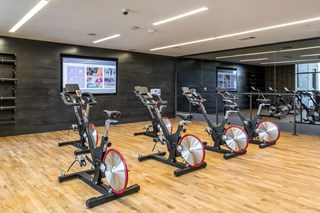 flex fitness spinning class equipment in well lit space
