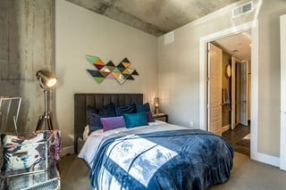 industrial-inspired bedroom with queen sized bed