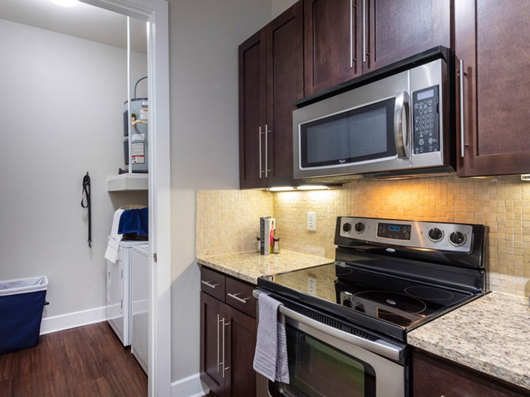 Electric Range In Kitchen at Domain at CityCentre, Texas, 77024