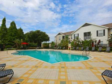 Lounging by the Pool at RiverTree, 5959 Bandera Spring Circle, 33578