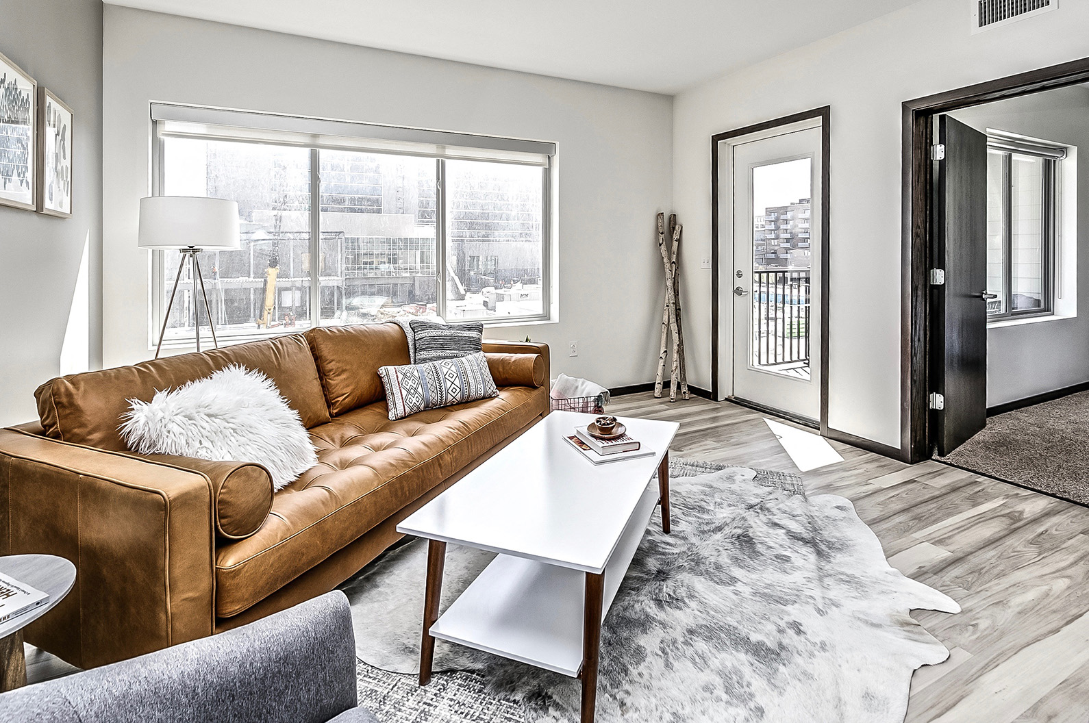 Living Room With Over-sized Windows at Capitol District, Omaha, 68102