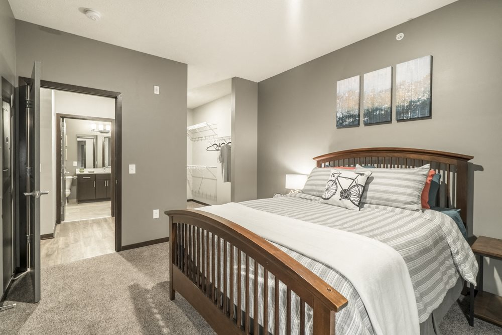 1-bedroom apartment with king-size bed and walk-in closet at The Conrad in Blackstone District Omaha