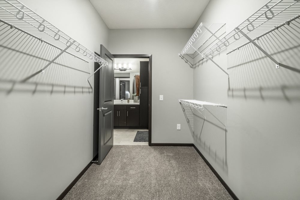 Spacious walk-in closet at The Conrad apartments in midtown Omaha NE