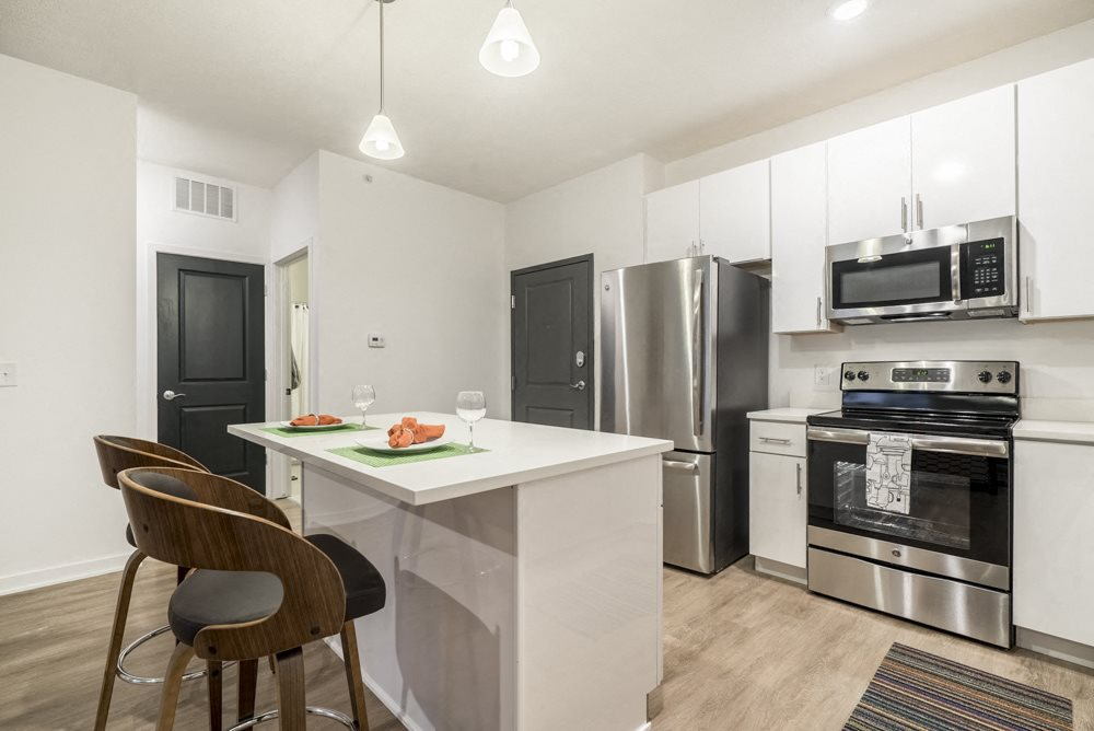 1 bedroom apartment with white cabinets and stainless steel appliances near UNMC in Omaha's Blackstone District
