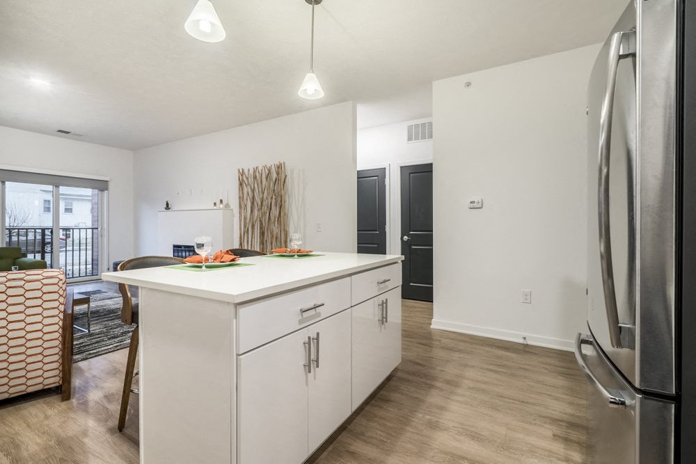 Kitchen island in 1 bedroom apartment for rent in contemporary design at The Conrad apartments
