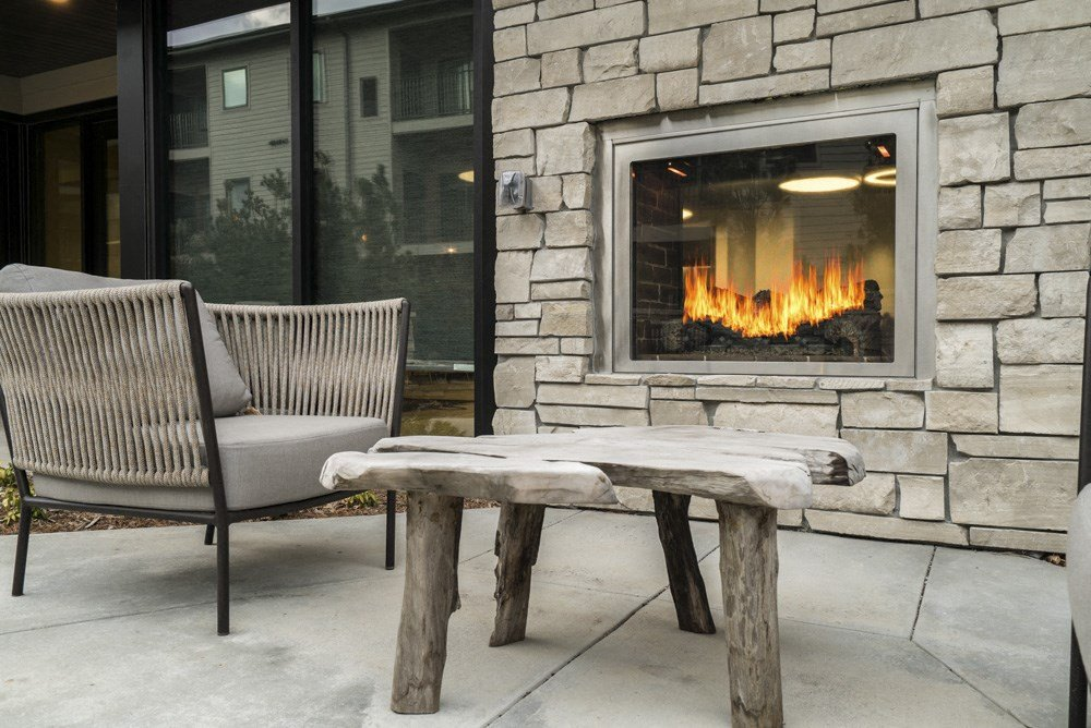 Indoor-outdoor fireplace at The Conrad apartments in Omaha NE
