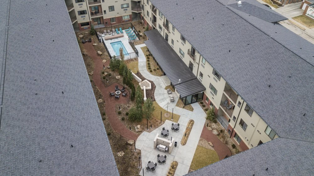 Courtyard with pool at The Conrad apartments in Blackstone District Omaha NE