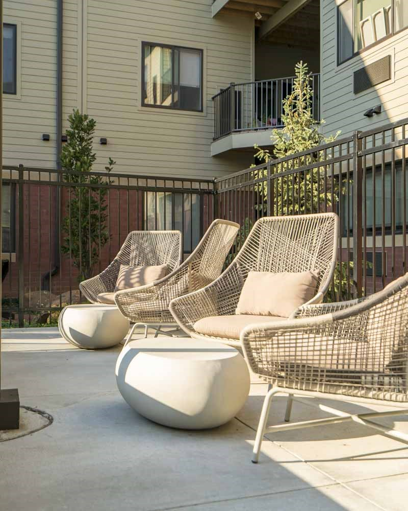 Trendy seating near the hybrid pool/hot tub at The Conrad near UNMC in the Blackstone District Omaha NE 68105