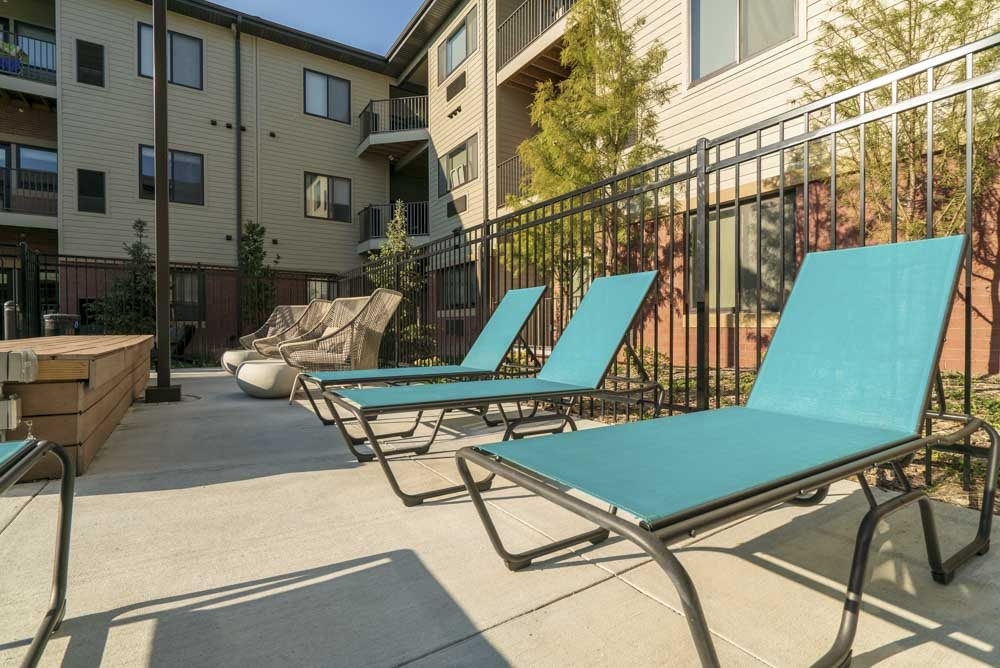 Lounge chairs near the hybrid pool/hot tub.