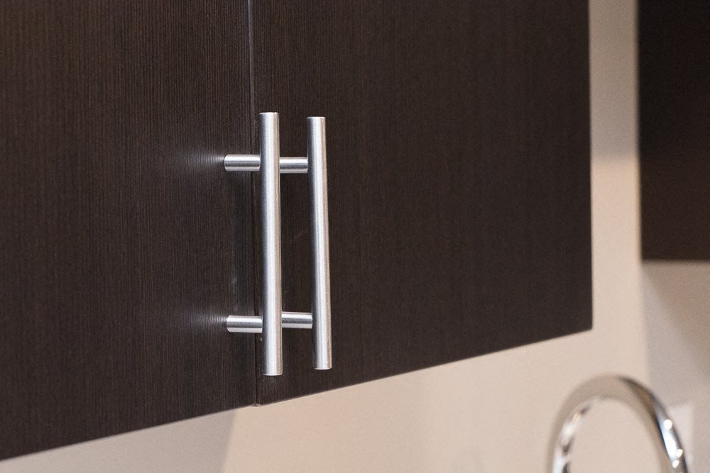Modern hardware on cabinets at The Conrad in traditional design scheme
