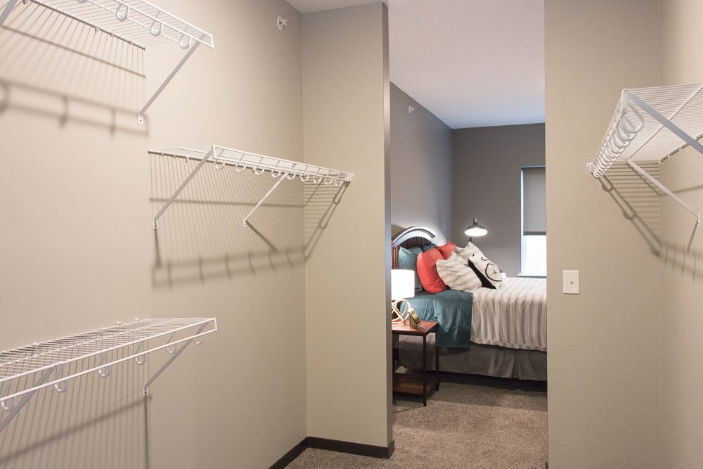 Interior view of walk-in closet of master bedroom at The Conrad