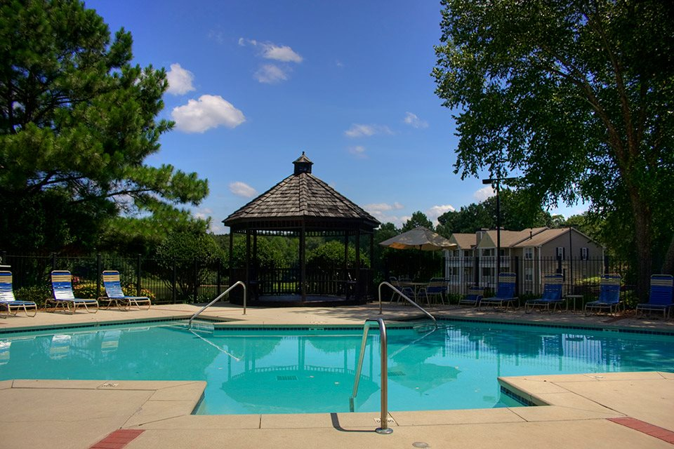 Serene sparkling pool with leisure deck and Wi-Fi at Lakeside at Arbor Place apartments in Douglasville, GA
