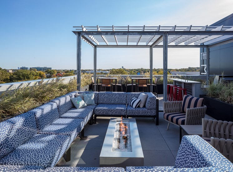 Outdoor terrace with lounge furniture and grill station
