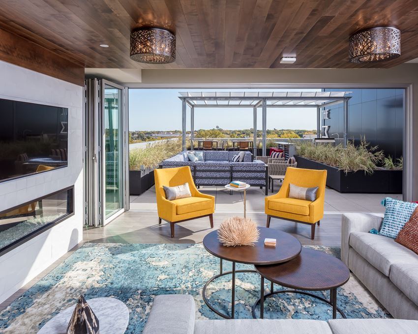 Entertainment suite with doors to an outdoor terrace