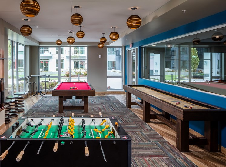 Game room with pool table, foosball and shuffleboard table