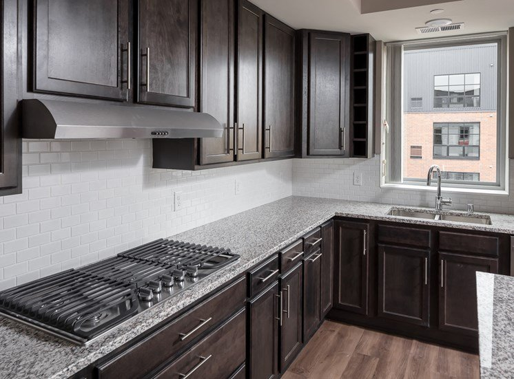 Kitchen with granite countertops and gas range