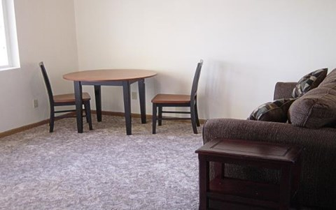 Unit interior with couch and table with chairs