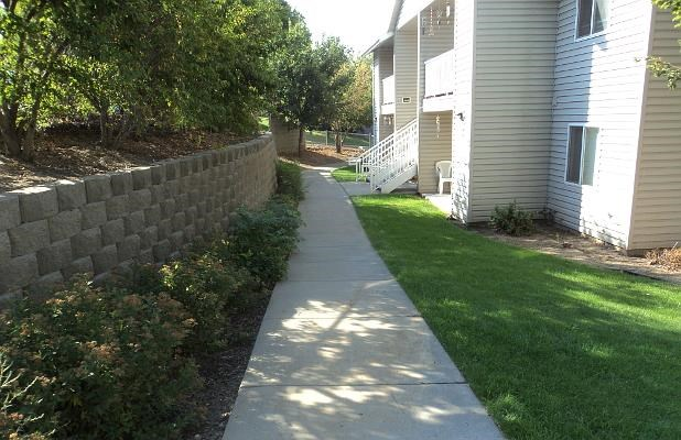 Retaining wall and sidewalk