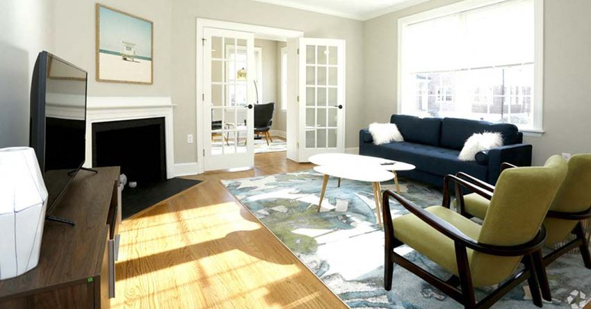 Living room with french doors and large windows