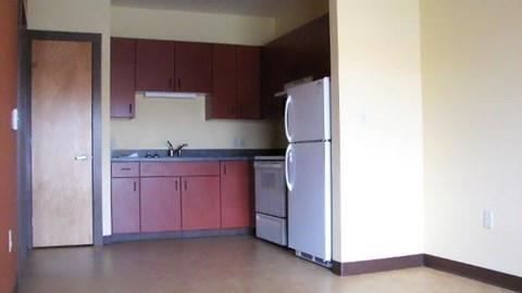 Kitchen with fridge and range