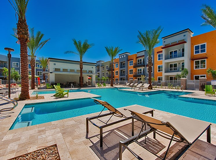 Swimming Pool with Lounge Chairs at Tempo at McClintock Station, 1831 East Apache Blvd, Tempe, AZ