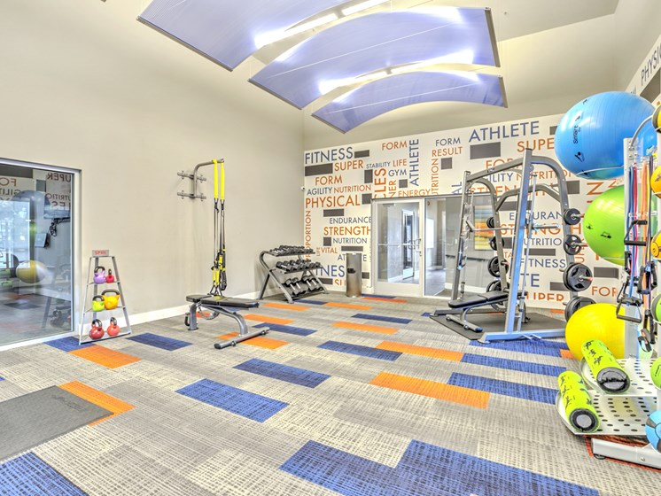 Apartments in Renton WA - The Windsor Apartments Fitness Center With Smith Machine, Free Weights, and Various Fitness Equipment