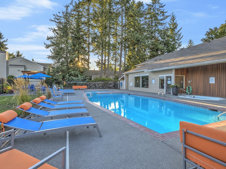 Apartments for Rent in Renton WA - The Windsor Apartments Swimming Pool With Poolside Lounge Chairs and Shaded Seating
