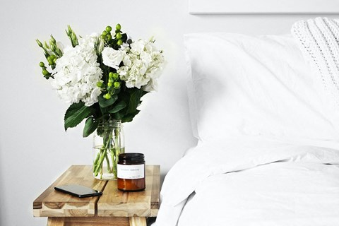 White Flowers on Bedside Table