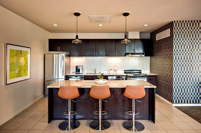 Gourmet Kitchens with Islands, Caesarstone Countertops, and Decorative Backsplash at Aspira Apartments